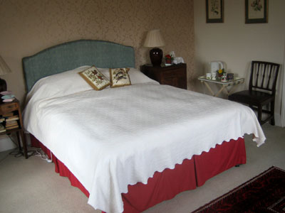 Image of double bed with white cover